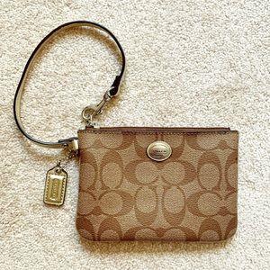 Coach | Metallic gold & brown leather wristlet